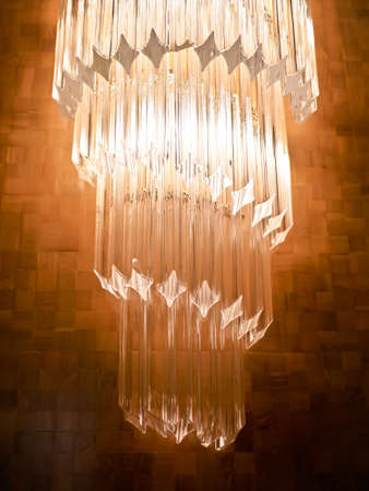 Wall lamp decorated with crystal on the wooden wall
