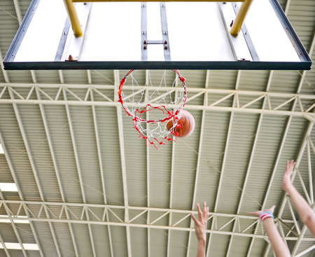 Action shot of basketball missed the hoop then players rebound Stock Photo