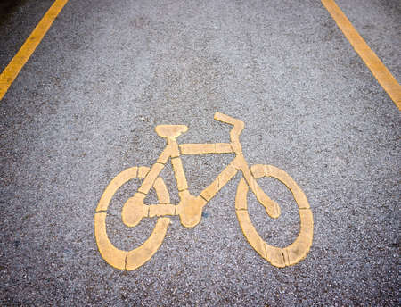 Bicycle lane with yellow sign painted on the road photo