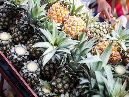 selling service: Many pineapple in pushcart selling on the street. Also offer free peeling service.