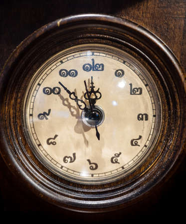 Thai vintage wooden clock at eight minutes before midnight Stock fotó