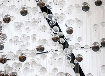 many balloons decorate on the ceiling in one of the special occasion party