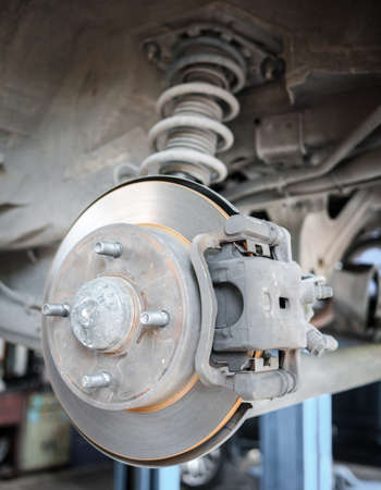 standard steel: Standard car disc brake with suspension in the back Stock Photo