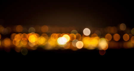 Bokeh abstract background in orange and gold color Stock Photo