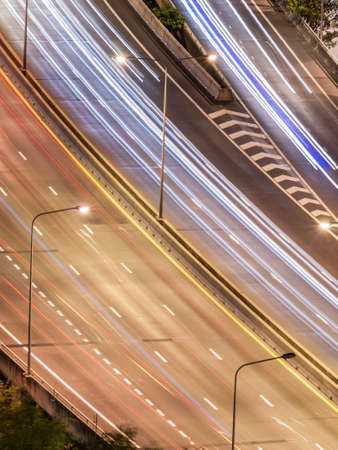 tollway: Curve of tollway traffic movement at night. Shot in birds eye view.