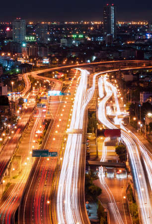 tollway: Bangkok tollway traffic movement at night. Shot in birds eye view. Stock Photo
