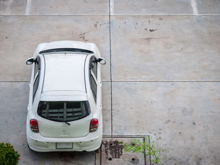 White car parking. Image shot from top view photo
