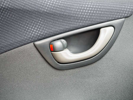 Car door locked focus on the red color lock photo