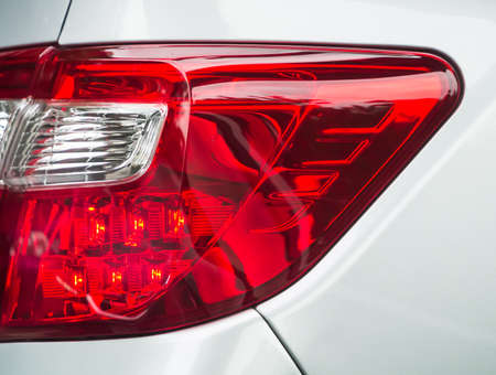 Red taillight, led design, closeup from the white car