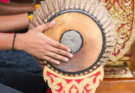 People playing Thai vintage drum for traditional music Stock Photo