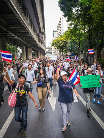 amnesty: BANGKOK, THAILAND - NOVEMBER 11, 2013  Protesters walking on the road in front of the police headquarter to fight against amnesty bill