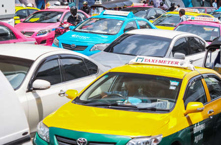 BANGKOK, THAILAND - AUGUST 06, 2013: Very bad traffic in the center of Bangkok city. The number of vehicles registered in Bangkok rose to 7.5 million but the Bangkok Metropolitan Authority says the city can only accommodate 1.6 million vehicles.
