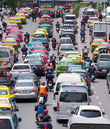 accommodate: BANGKOK, THAILAND - AUGUST 06, 2013: Very bad traffic in the center of Bangkok city. The number of vehicles registered in Bangkok rose to 7.5 million but the Bangkok Metropolitan Authority says the city can only accommodate 1.6 million vehicles.