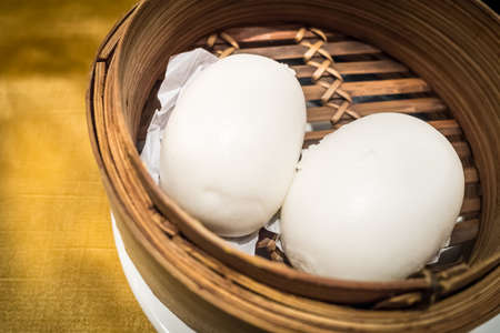 Dim Sum, Chinese bun, steamed in bamboo container. Stock Photo