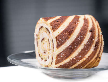 Vanilla roll bread in glass dish serving in coffee break during business meeting