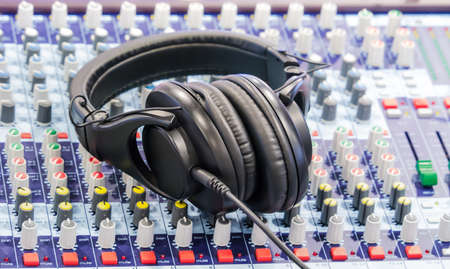 Headphone placed on mixer symbolize of sound engineer and dj occupation