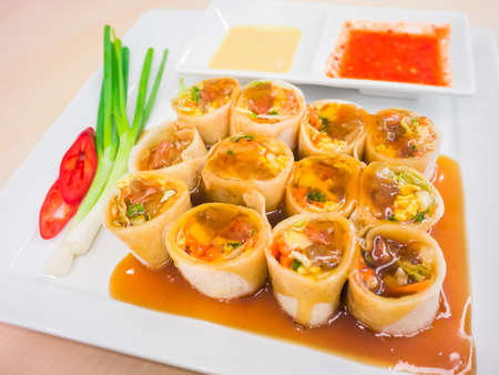 Chinese spring roll served with spicy dipping sauces
