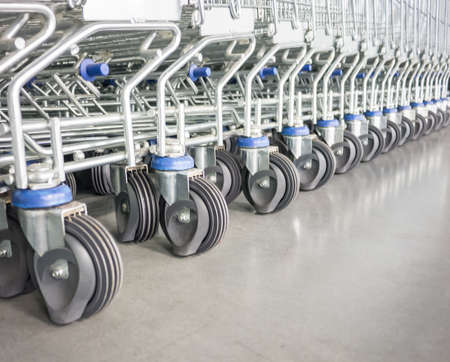 purchasing power: Row of shopping cart wheels symbolize of retail store with high purchasing power