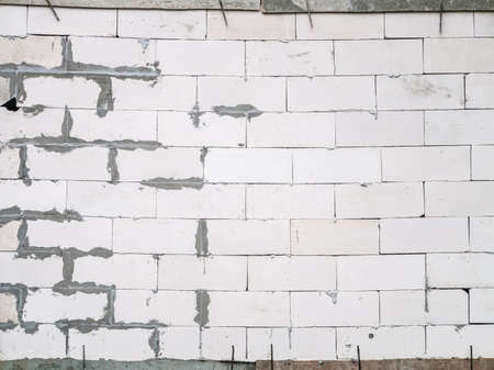 unprofessional: Untidy wall built symbolize of unprofessional construction