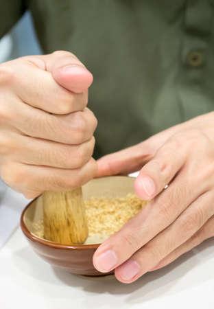 pounding: Hand pounding white sesame as for making japanese dipping sauce