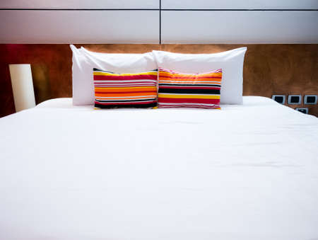 good night: Clean and neat bed in concept of pleasure stay and good night  Stock Photo
