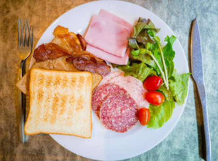 Food in plate in contrast of good and bad breakfast