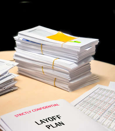 layoff: Business financial statement with envelops on planning table symbolize of layoff plan Stock Photo
