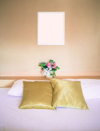 Clean bed, well decorated, processed in warm tone Stock Photo