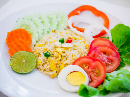 Fried rice with boiled egg slice and salad symbolize of healthy food Stock Photo