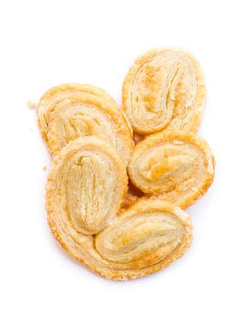 french pastry: Palmier, una pasteler�a francesa en la palma o mariposa forma, aislado en fondo blanco