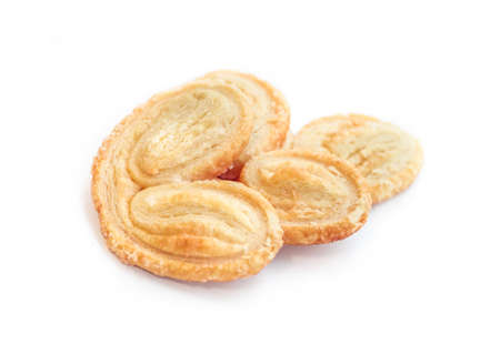 Palmier, a French pastry in palm or butterfly shape, isolated on white background Stock Photo