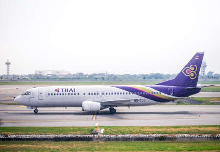 downsize: BANGKOK, THAILAND - JANUARY 28, 2015: Thai Airways HS-TDG (Boeing 737) taking off from Suvarnabhumi Airport.