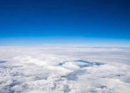 Aerial cloudscape sky in stratosphere shot from airplane window Stock Photo