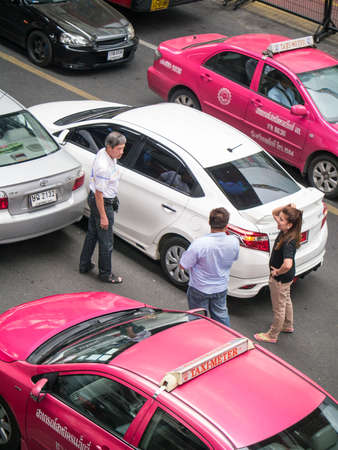 BANGKOK, THAILAND - MAY 7, 2014: Unidentified people arguing about the car accident in the middle of the heavy traffic road