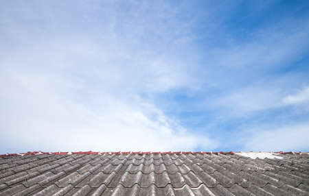 asbestos: Cloudy sky over the asbestos roof tiles able to use as background