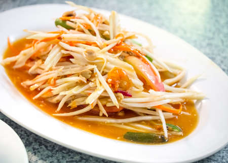 Green papaya salad, also known as Som Tum, the hot and spicy favourite appetizer from Thailand