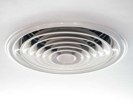 Circular air ventilation duct on the ceiling in white