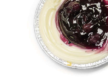 Blueberry cheesecake at top right isolated on white background