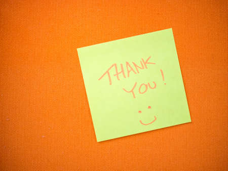 Thank you message noted in the yellow paper on orange board