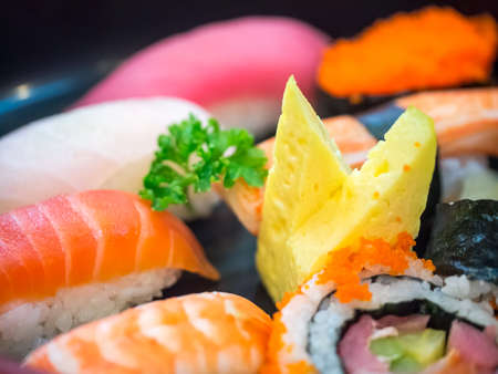 Closeup of mixed sushi in black background Stock Photo