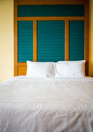 Clean bed in the morning processed in warm tone Stock Photo