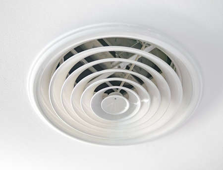 ceiling: Circular air ventilation duct on the ceiling in white