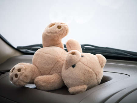 Teddy bear in car in concept of traveling with children