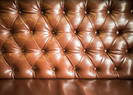 Brown buttons leather  sofa in low key able to use as background
