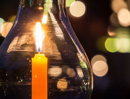 Candle light lantern with bokeh in concept of praying Stock Photo
