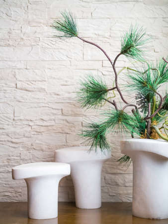 Contemporary home decoration with artificial tree and stone wall Stock Photo