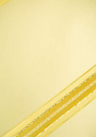 rewarding: Golden ribbon on yellow space in elegance rewarding background concept