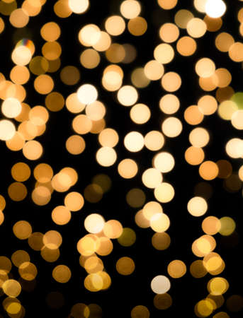 Bokeh abstract background in gold color