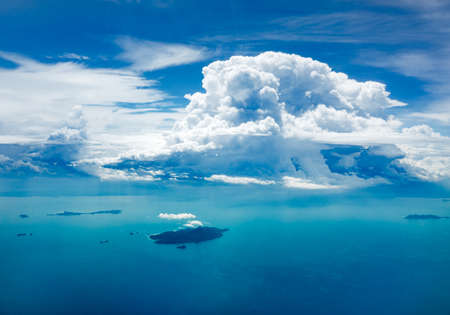 Cloud and ocean with island, shot from aerial view Stock Photo