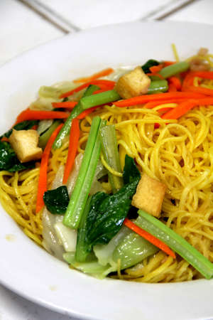Delicious Stir-fried rice noodles colorful appetizing and Yummy on white dish photo